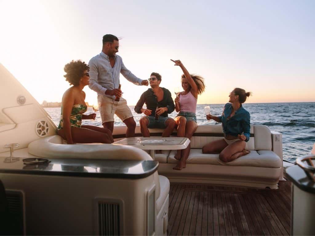 Friends having fun onboard a yacht charter in Singapore